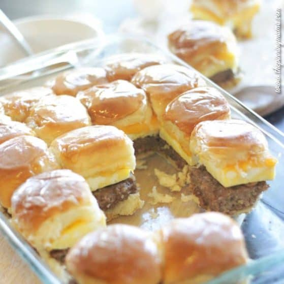 Everything breakfast should be! Sausage egg and cheese breakfast sliders with syrup glaze. Sweet and salty heaven!!!