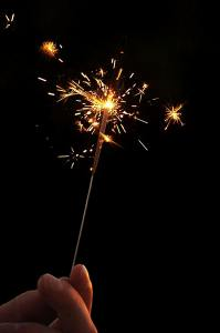 This shows someone holding a lit sparkler