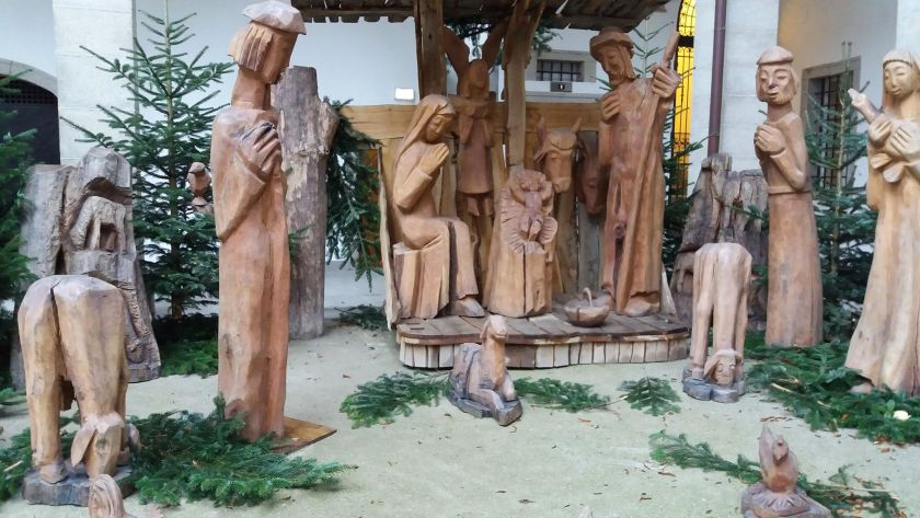 Life size wooden nativity figures in the snow
