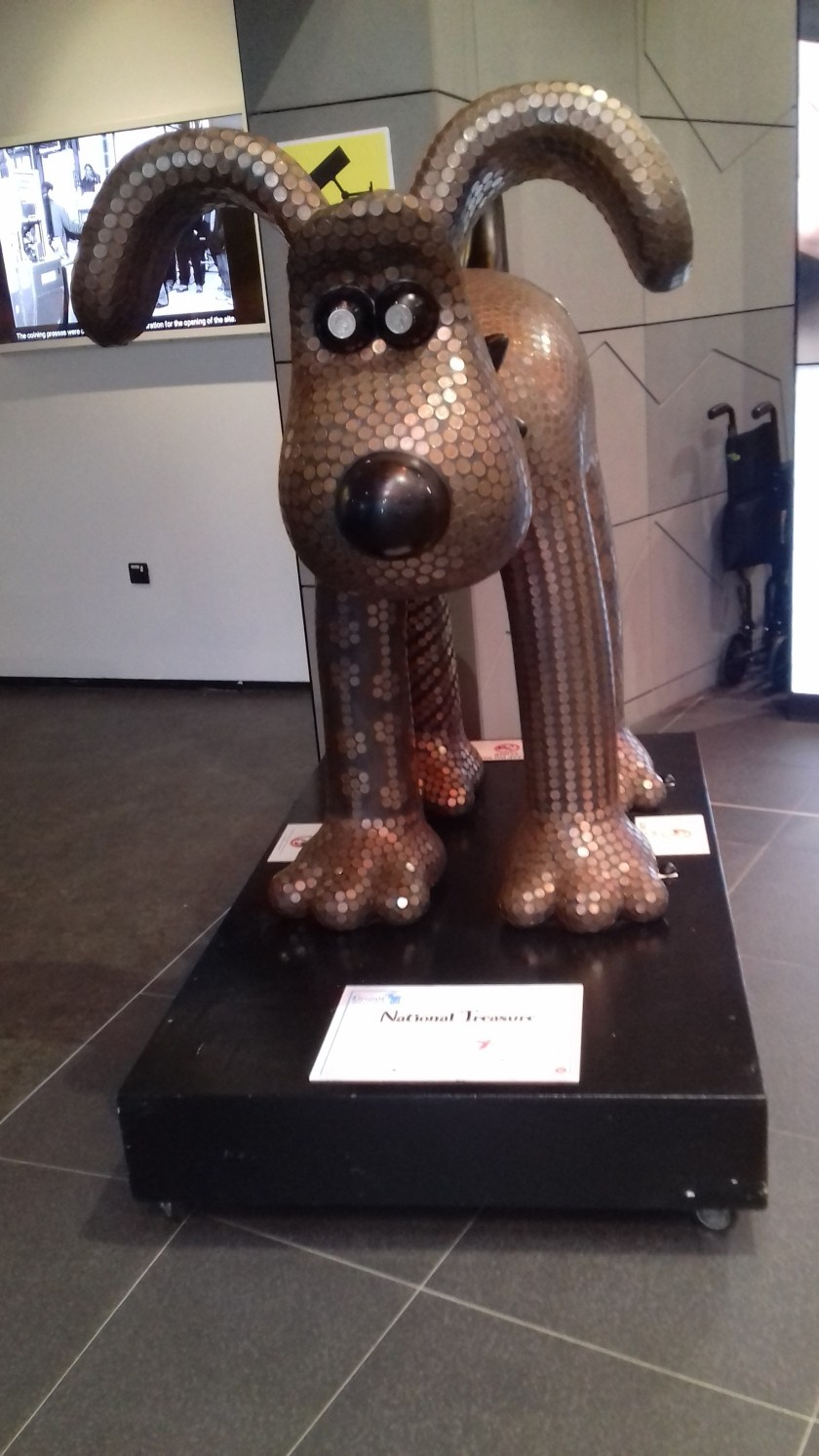 Gromit covered with new pence.