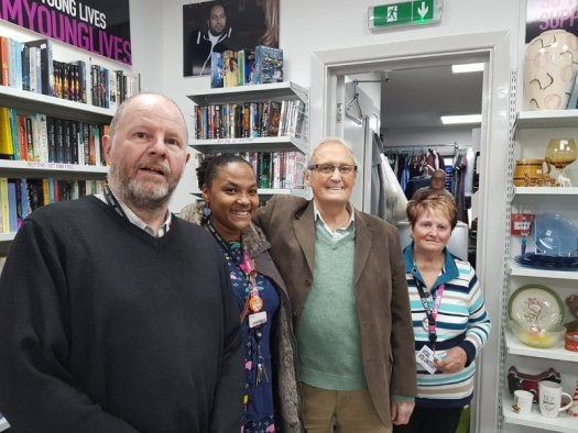 A photo of the staff of the Clic shop with Mr. Woodward.