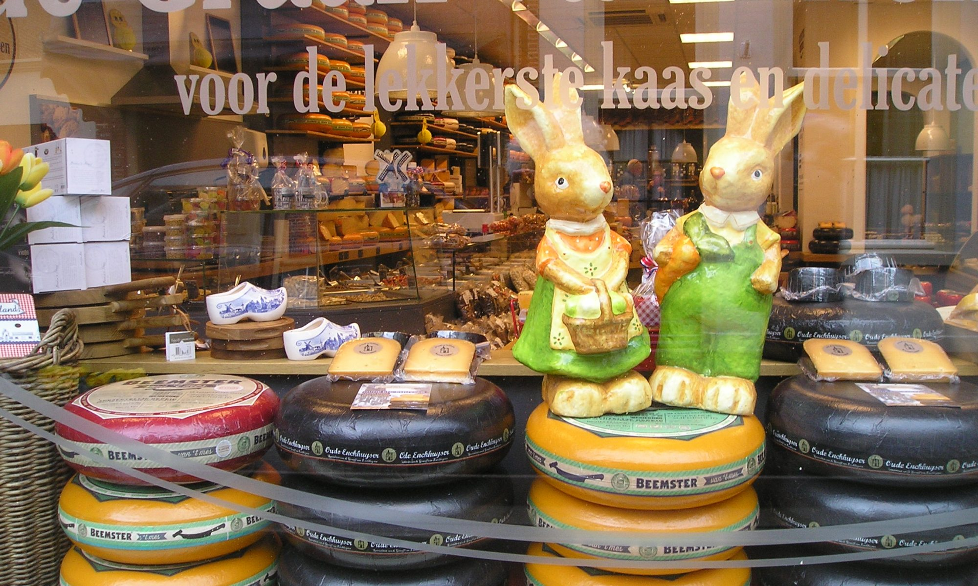 Two chocolate Easter bunnies were on top of the cheeses