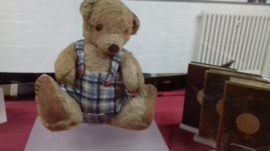 An old Chad Valley teddy bear wearing checked shorts.