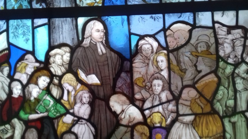This stained glass window shows John Wesley preaching outdoors #newroom