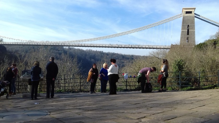 People looking at the suspension bridge