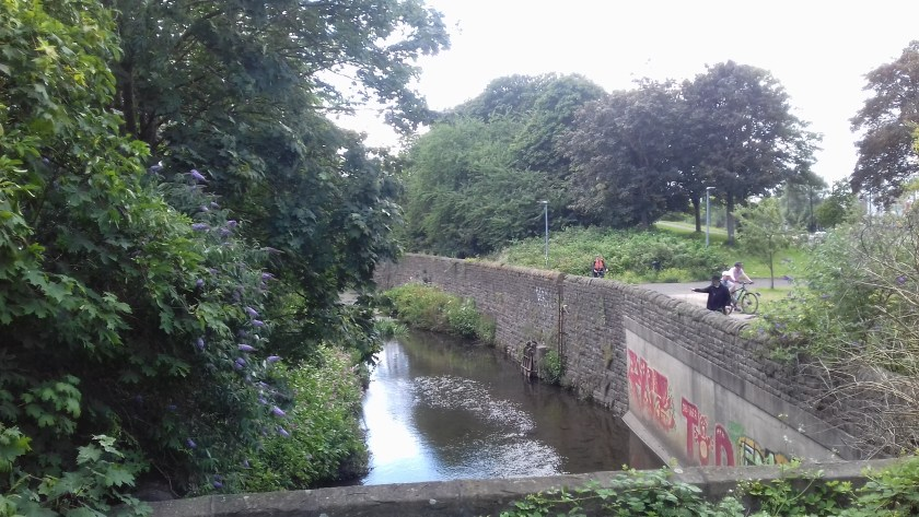 The river Frome with grafitti on the stone work.