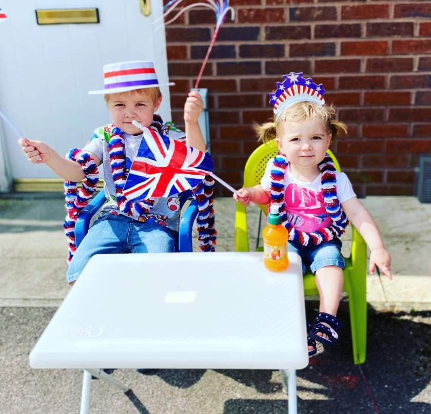My randchildren in red white and blue fancy dress enjoying V.E. day