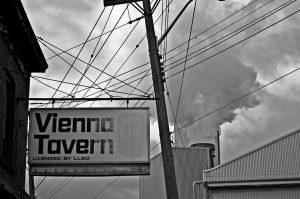 Vienna Tavern against a smokestack.