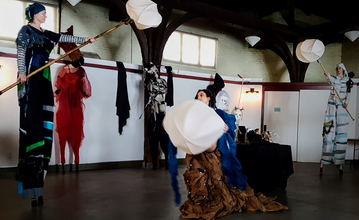 Stilt walkers and actors perform the history of water treatment and delivery in Hamilton.