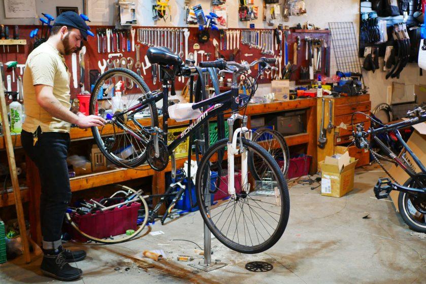 Jack services a bike.