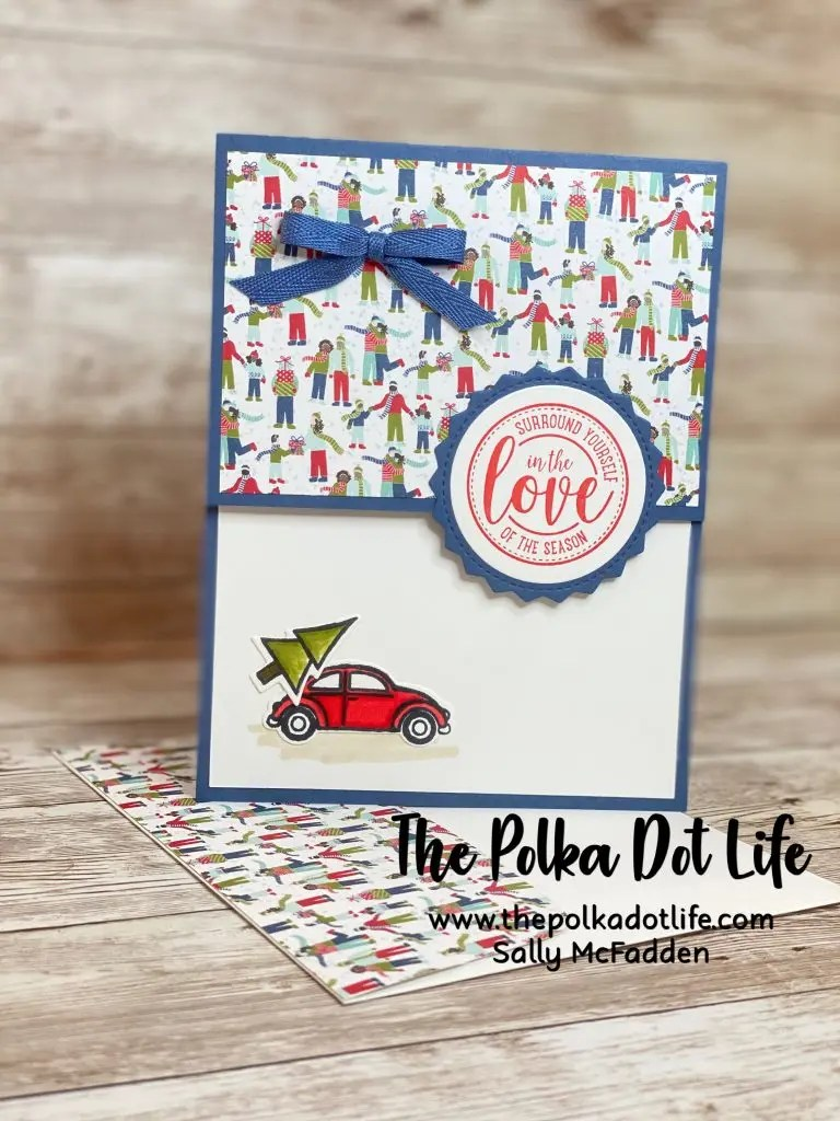 A greeting card that features a cute little red car hauling a Christmas tree.  It is made with products from Stampin' Up's Trimming the Town Suite.