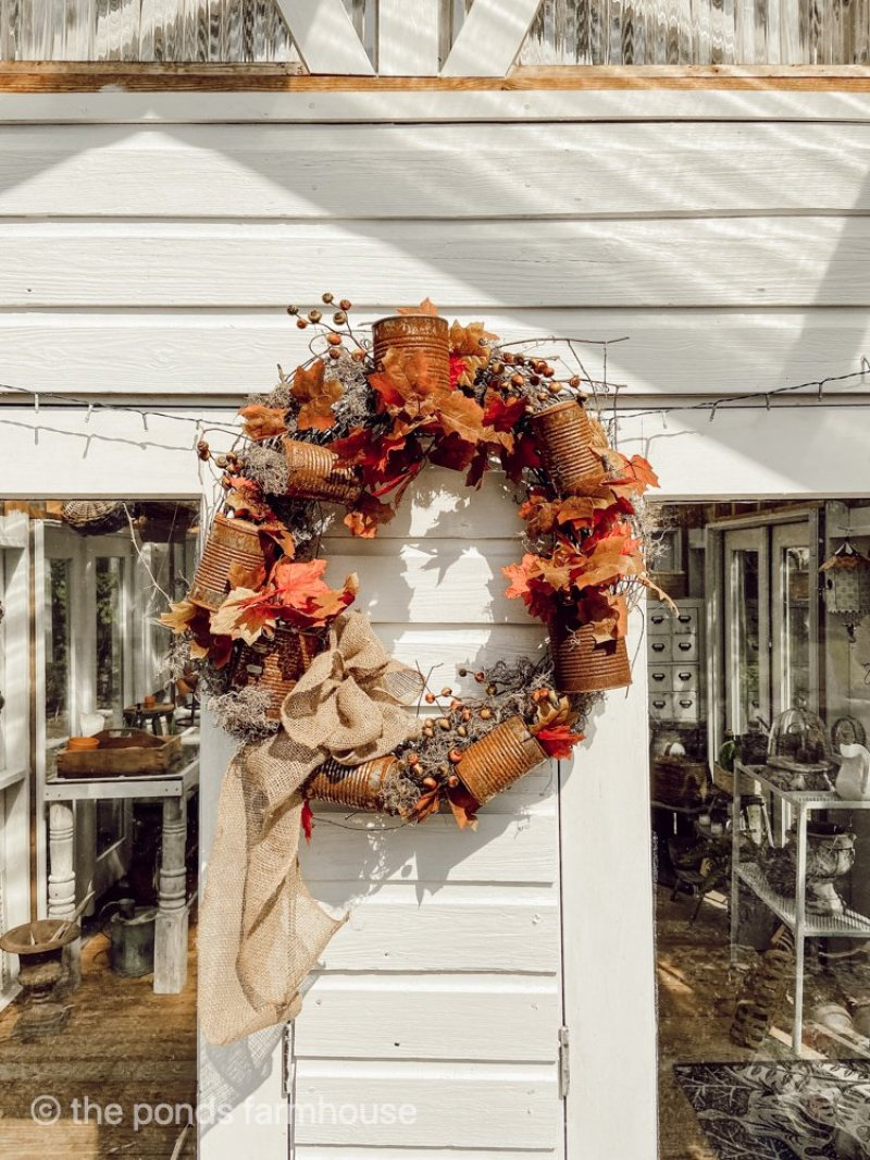 Tin Can Craft Project made from rusted cans, grapevine and Dollar Tree Florals. Easy, inexpensive diy project for fall decorating. Farmhouse style