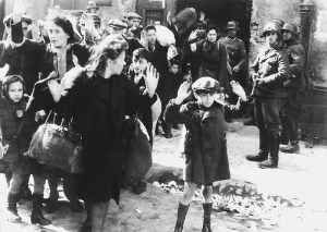 SS soldiers guarding the column of captive Jews in the Warsaw ghetto.