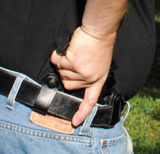 Full combat grip on holstered gun.
