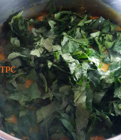 shredded anala leaves in the pot of anala soup, ofe ukpom