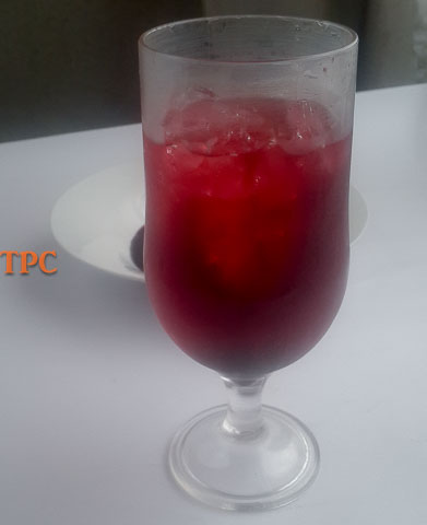 Chilled zobo syrup, zobo drink. Ruby red nectarous drink.