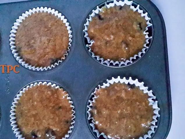 cinnamon muffin batter in muffin tin
