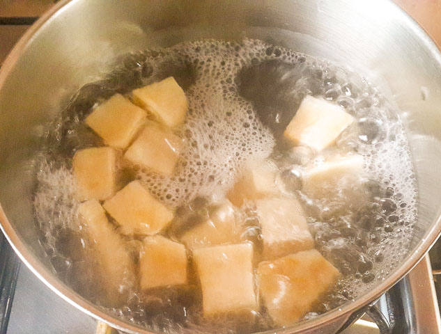 yam cubes boiling in a pot for vegetable yam