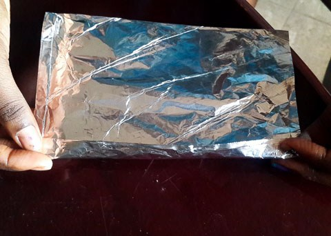 foil pocket ready to be filled with okpa mix