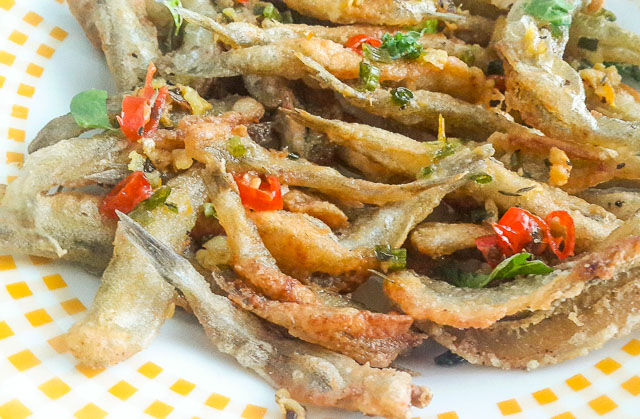 Crunchy, salty and spicy Nigerian crispy fried whitebait fish in Herb butter sauce