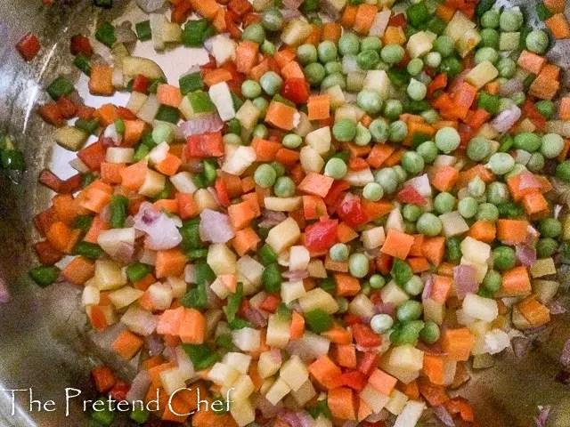vegetables frying for Nigerian vegetable pie