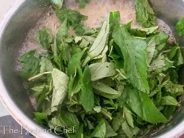 Ewedu (jute) leaves boiling in a pot for Ewedu Soup