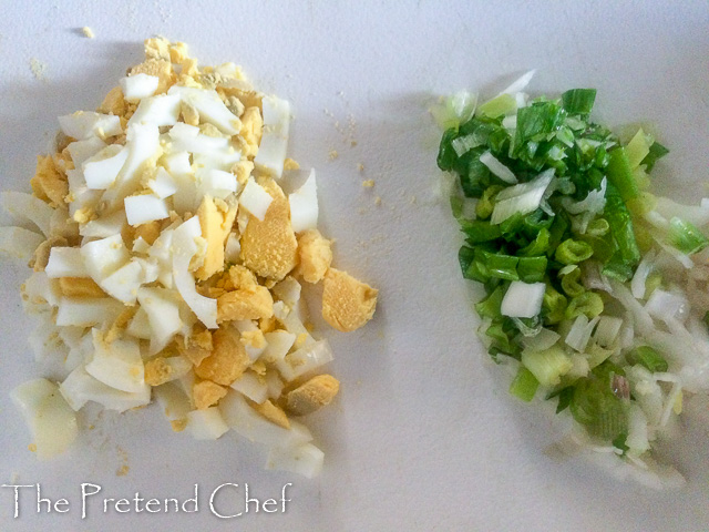 chopped ingredients for Egg and Sardine empanada filling
