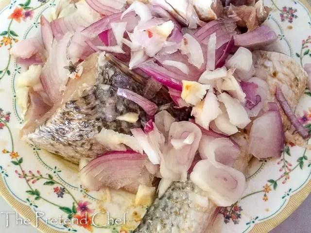fish marinating for Nigerian fish stew (Imoyo)