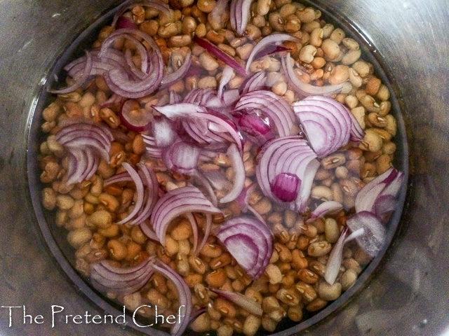 beans and onions in a pot