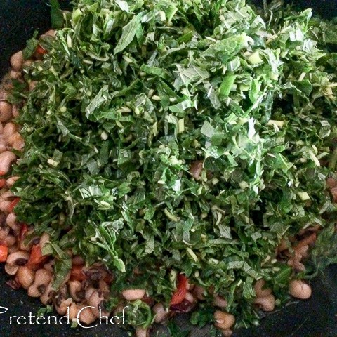 Nigerian Greens and beans cooking in a pot