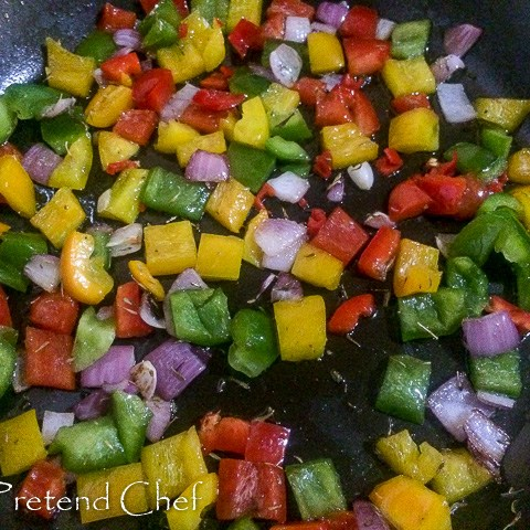 peppers and onions frying in a pan for Couscous with bell peppers