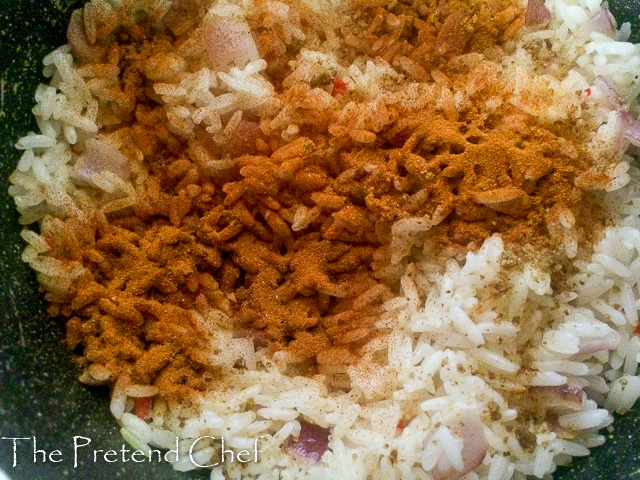 turmeric sprinkled over parboiled rice