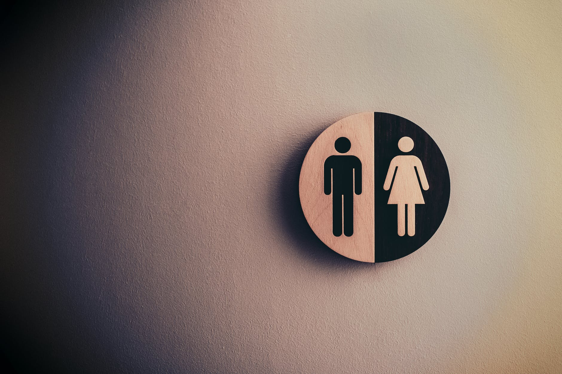 male and female signage on wall