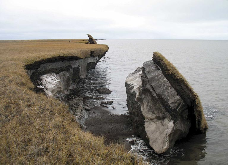 Image: US Geological Survey, Collapsed permafrost block of coastal tundra on Alaska's Arctic Coast, Wikimedia Commons, Public Domain