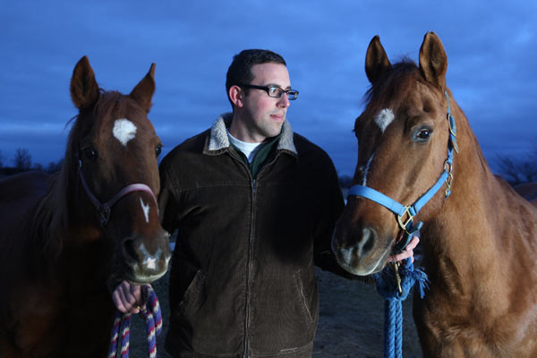 Portrait of Randy Hamelin, a registered professional counsellor and equine professional with horses at his farm in Lakeshore, Ontario on February 7, 2012.