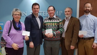 Torbay Charities receiving Foster's Fund from Kevin Foster