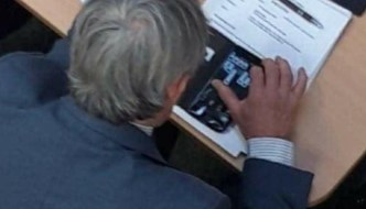 Tory councillor photographed playing solitaire on his phone during a crucial meeting