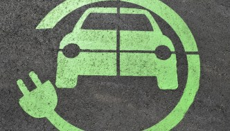 an image of a car encircled by a plug painted in green on tarmac
