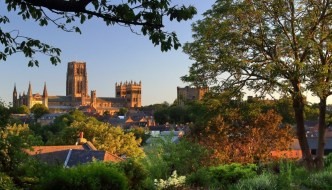 durham cathedral in the distance through trees