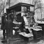 From March 1934, a news vendor's stand in New York's Madison Square Park offers several pulp magazines for sale.