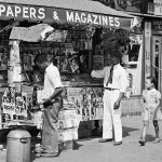 "A newsstand in Harlem includes several pulps from July 1939 deep within its display, including ""Horror Tales,"" ""Ace G-Man Stories,"" ""The Spider,"" ""Doc Savage,"" ""The Shadow,"" ""Operator #5,"" and ""Love Tales."""