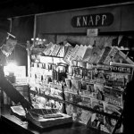 "Pulps are hard to see in this photo taken during a dim-out of New York City on May 20, 1942, during World War II. There are a ""Black Mask"" and an ""Amazing Stories"" clearly visible, as well as several ""true"" detective magazines."