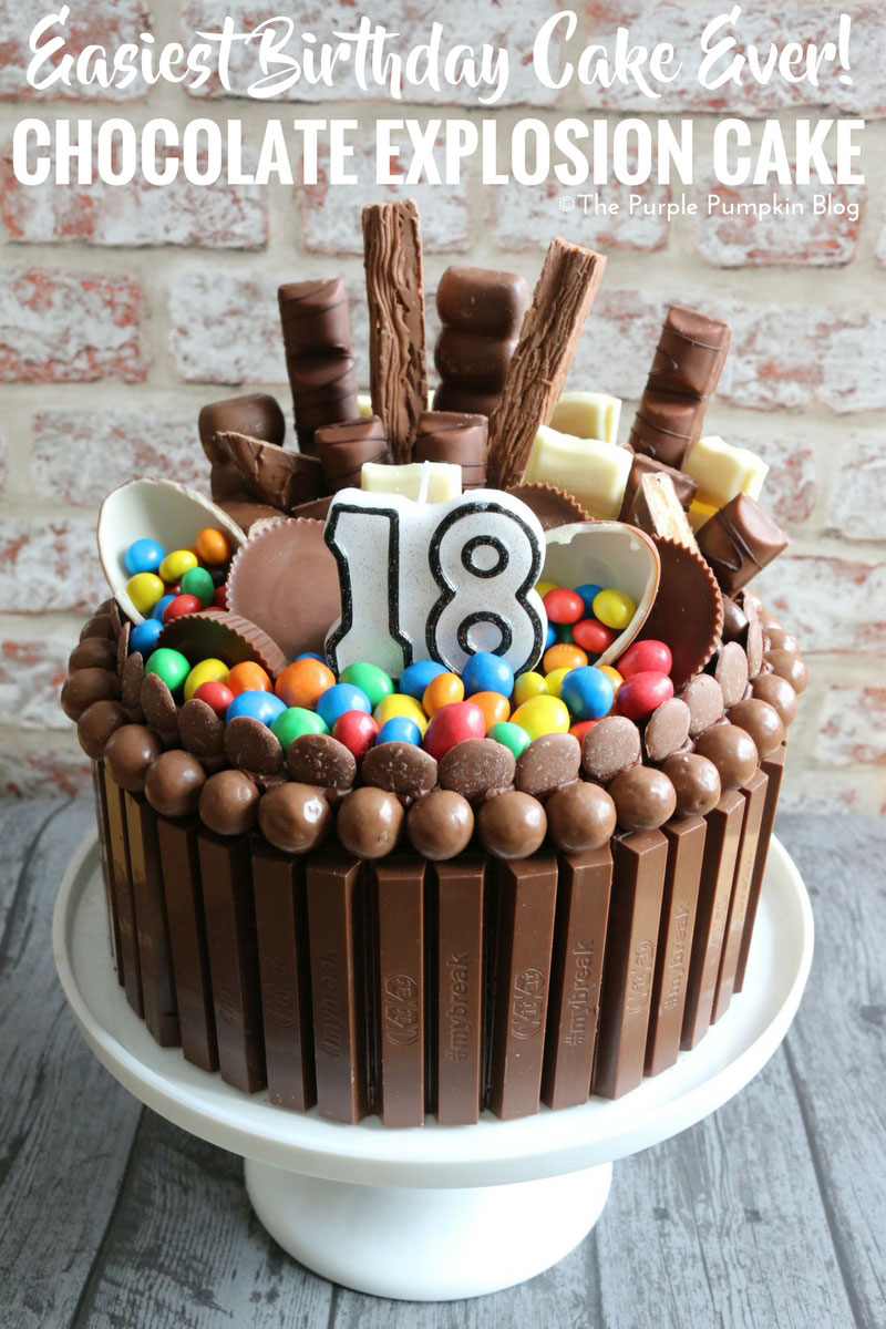 A chocolate cake covered in lots of chocolate and candy bars - a chocolate explosion cake, the easiest birthday cake ever!