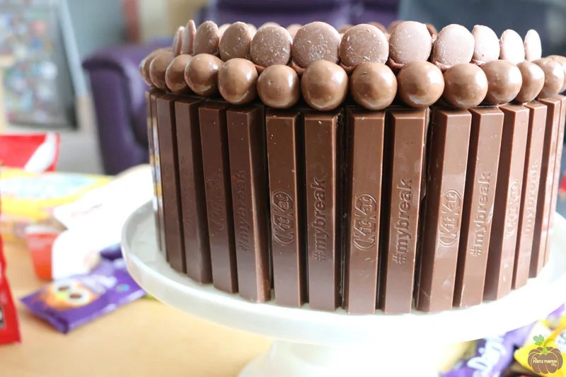 Chocolate cake surrounded by KitKat bars