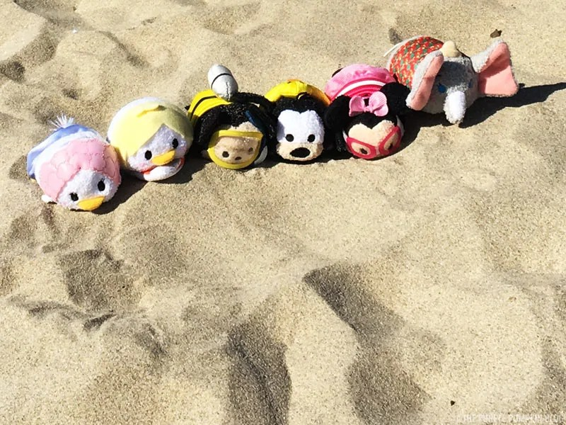#TsumTsumTravels on the beach in Portugal. Tsum Tsum toys all lined up on the sandy beach.
