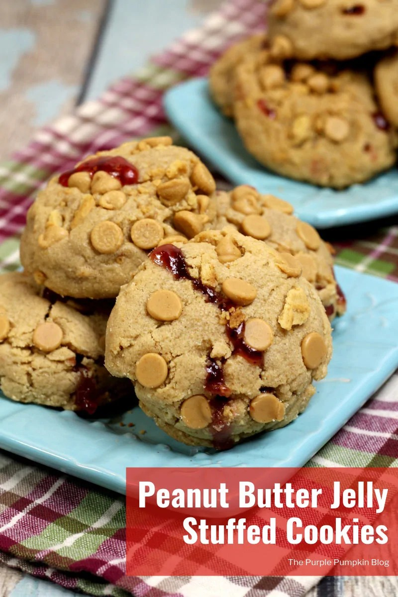 These Peanut Butter Jelly Stuffed Cookies are a must bake for peanut butter lovers everywhere! They take peanut butter cookies to the max with not only peanut butter as an ingredient, but the cookies are rolled in peanut butter chips, and Nutter Butters... And then, they are injected with delicious jam for the ultimate PB&J cookie! #PeanutButterCookies #PeanutButterJellyCookies #ThePurplePumpkinBlog