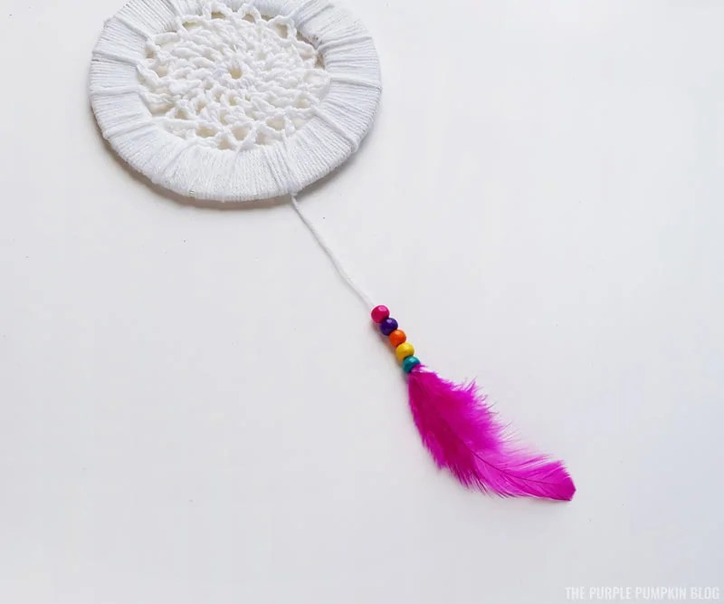 Attached feathers and bead hangers to dream catcher