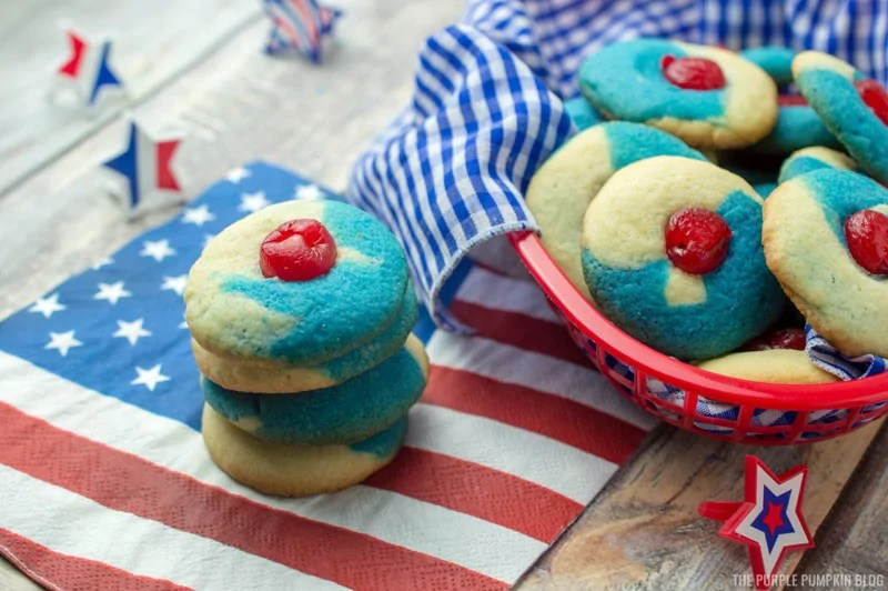 A stack and basket of Patriotic Thumbprint Cookies on a US flag napking
