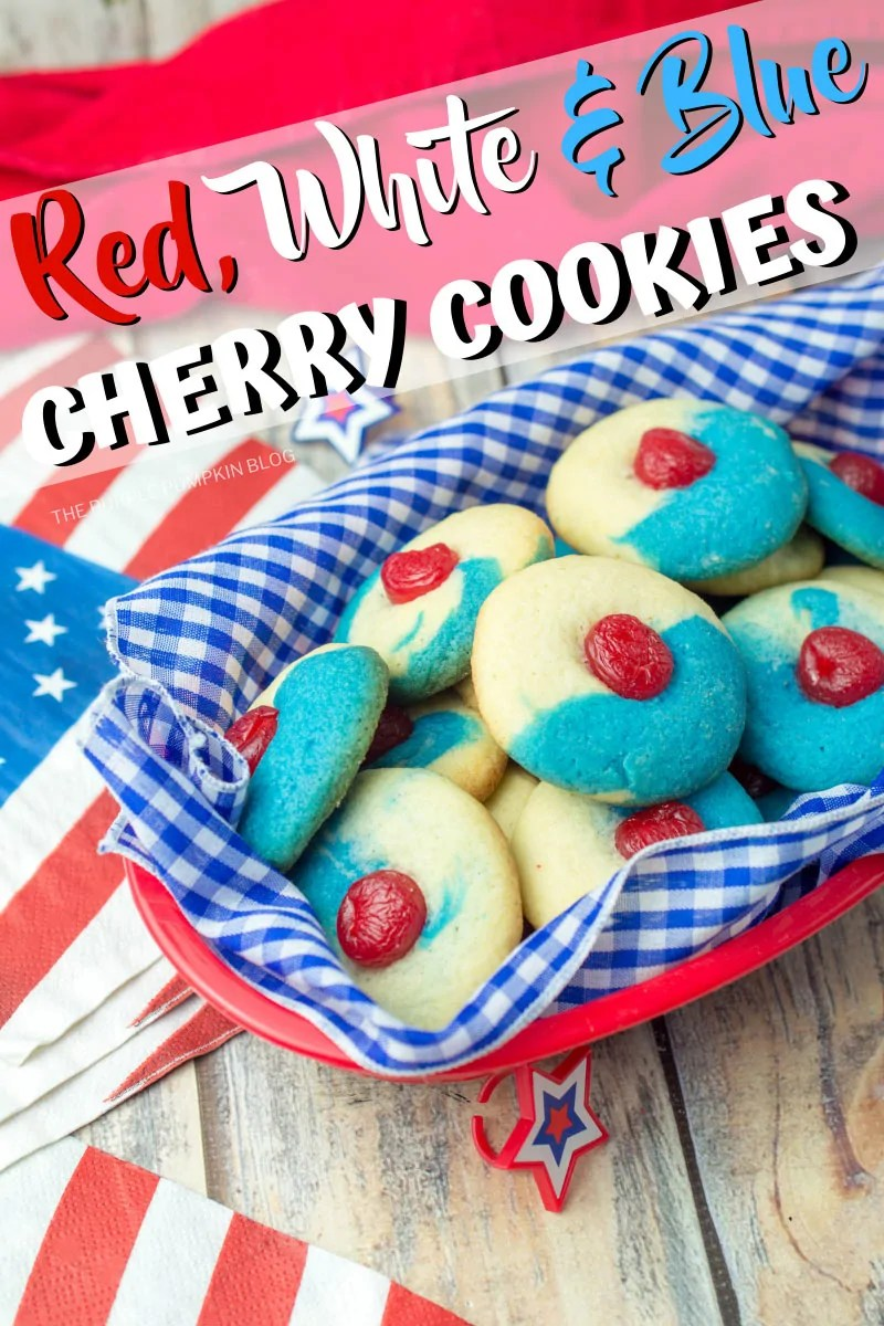 Basket of red white and blue cookies topped with cherries.