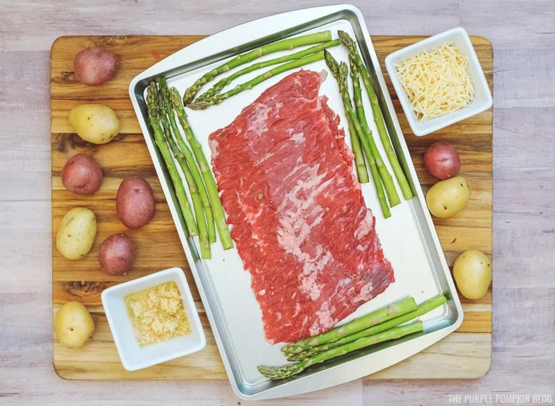 Steak on sheet pan with asparagus